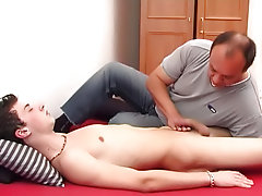 This lucky boy awakened from the slumber brought about by his mature masseur only when his shaft was balls deep in the man's mouth nude male hunk