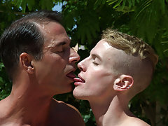 Cute gay boys kissing with black...