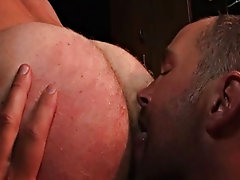 Stubbly Dane services Trojans protruding cock from his zippered jockstrap before he drops it all and fucks his mates face, giving him cock and balls t
